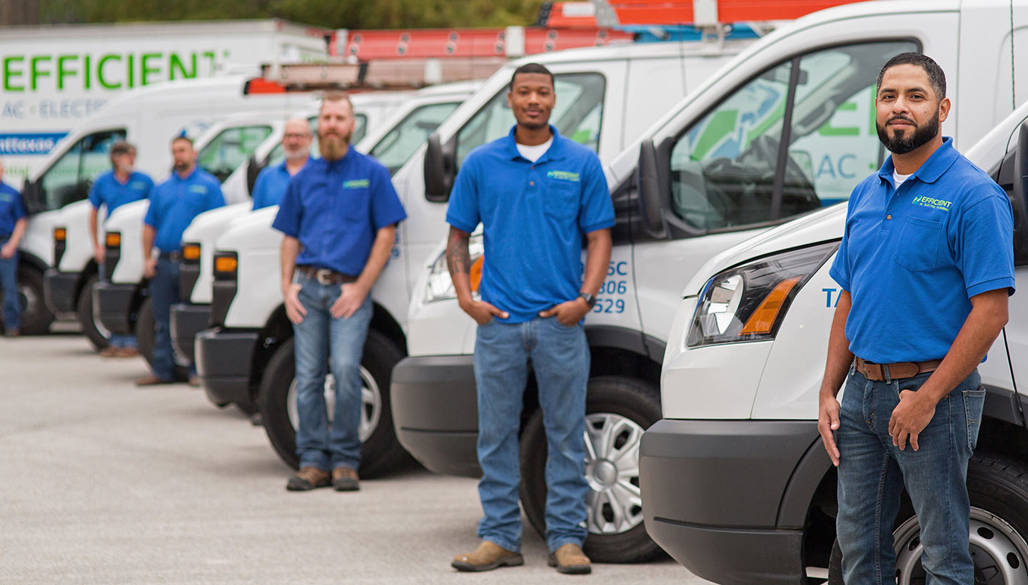men standing outside Efficient Air Conditioning company vans