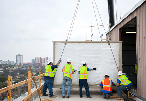 men installing unit at Travis County Executive Office Building